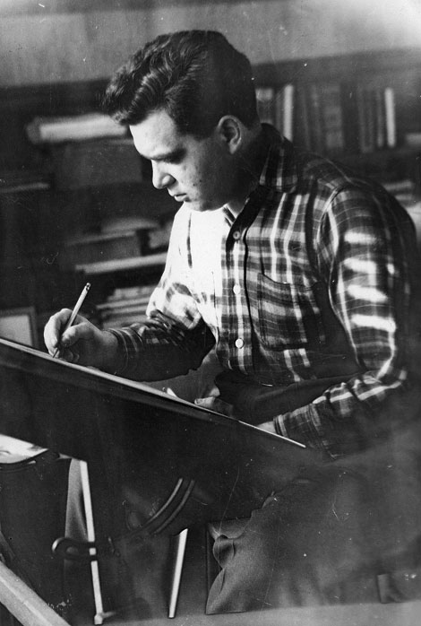 "Jack Kirby at work in ""The Dungeon"" — his basement studio — in 1949."